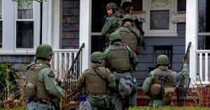 Searching for bombers is one thing; door to door harassment and gun confiscation is quite another