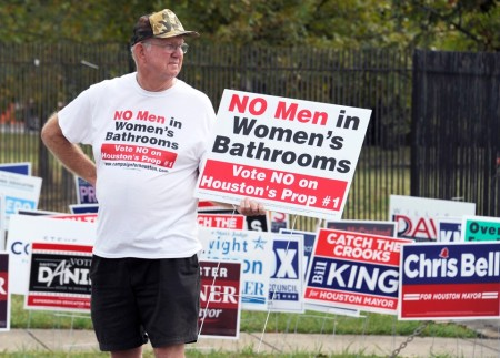 File - In this Oct. 21, 2015 file photo, a man urges people to vote against the Houston Equal Rights Ordinance outside an early voting center in Houston. On Tuesday, Nov. 3, 2015, voters statewide can give themselves tax breaks, pump billions of dollars into roads and make hunting and fishing constitutional rights by supporting seven amendments to the Texas Constitution on Tuesday's ballot. And Houston will choose a new mayor and decide whether to extend nondiscrimination protections to its gay and transgender residents in a referendum being watched nationally. (AP Photo/Pat Sullivan, File)