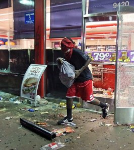 Here is a judicially involved youth in Ferguson, Missouri redistributing the wealth.